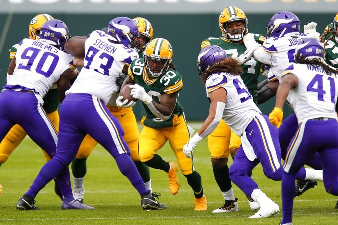 Green Bay Packers' Jamaal Williams runs during the first half of an NFL football game against the Minnesota Vikings Sunday, Nov. 1, 2020, in Green Bay, Wis. (AP Photo/Matt Ludtke)