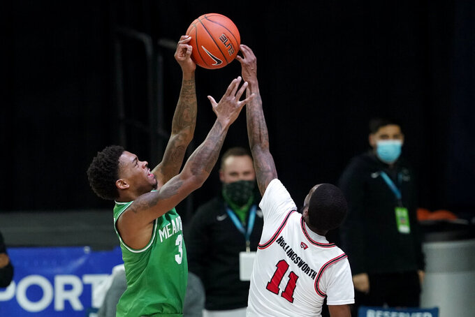 Western Kentucky guard Taveion Hollingsworth (11) blocks a shot by North Texas guard Javion Hamlet, left, during the second half of the championship game in the NCAA Conference USA men's basketball tournament Saturday, March 13, 2021, in Frisco, Texas. (AP Photo/Tony Gutierrez)