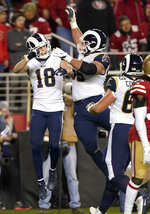 Los Angeles Rams wide receiver Cooper Kupp (18) celebrates with Austin Blythe, center, and Austin Corbett after scoring against the San Francisco 49ers during the second half of an NFL football game in Santa Clara, Calif., Saturday, Dec. 21, 2019. (AP Photo/Tony Avelar)