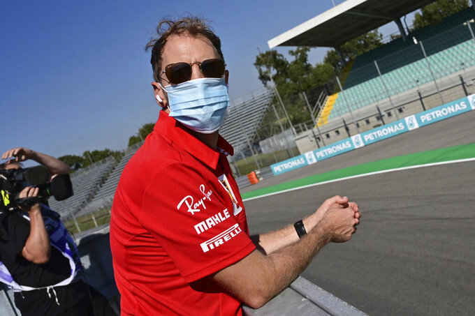 Ferrari driver Sebastian Vettel of Germany watches the last moments of the qualifying session at the Monza racetrack in Monza, Italy, Saturday, Sept.5, 2020. The Italian Formula One Grand Prix will be held on Sunday. (Miguel Medina, Pool via AP)