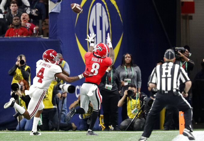 Georgia wide receiver Riley Ridley (8) prepares to make a touchdown catch against Alabama defensive back Saivion Smith (4) during the second half of the Southeastern Conference championship NCAA college football game, Saturday, Dec. 1, 2018, in Atlanta. (AP Photo/John Bazemore)
