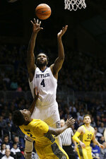 Butler forward Tyler Wideman (4) shoots over Marquette guard Sacar Anim (2) during the first half of an NCAA college basketball game in Indianapolis, Friday, Jan. 12, 2018. (AP Photo/AJ Mast)