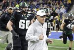 """FILE - In this Dec. 2, 2016, file photo, Ohio head coach Frank Solich runs onto the field with his team before the Mid-American Conference championship NCAA college football game against Western Michigan, in Detroit. Ohio coach Frank Solich is retiring after leading the program through 16 seasons of unprecedented success to """"focus on his health,"""" the school said Wednesday, July 14, 2021. The school announced that Solich was stepping down less than two months before the start of the season and his 77th birthday. Offensive coordinator Tim Albin was promoted to head coach.(AP Photo/Carlos Osorio, File)"""