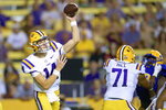 LSU quarterback Max Johnson (14) throws a pass during the first half the team's NCAA college football game against McNeese State in Baton Rouge, La., Saturday, Sept. 11, 2021. (AP Photo/Matthew Hinton)
