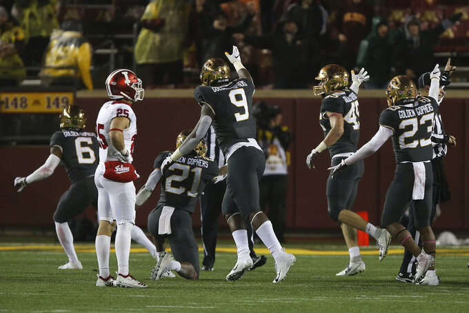 Minnesota's Esezi Otomewo (9) and teammates signal the possession of the ball after Indiana fumbled during an NCAA college football game Friday, Oct. 26, 2018, in Minneapolis. Minnesota won 38-31. (AP Photo/Stacy Bengs)