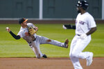 Baltimore Orioles shortstop Ramon Urias, left, throws for the out after fielding a grounder by Boston Red Sox's Michael Chavis during the seventh inning of a baseball game in Boston, Wednesday, Sept. 23, 2020, at Fenway Park. Advancing to third is Jackie Bradley Jr. (AP Photo/Charles Krupa)