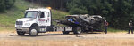 In this photo provided by The Macon Beacon, authorities remove one of several vehicles involved in a fatal crash Wednesday, June 5, 2019, near Scooba, Miss., in the same area where a crash took the lives of eight people two days earlier. Kemper County Sheriff James Moore told The Associated Press that
