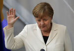 German Chancellor Angela Merkel takes the oath of office after Merkel was elected for a fourth term as chancellor in the German parliament Bundestag in Berlin, Germany, Wednesday, March 14, 2018. (AP Photo/Markus Schreiber)
