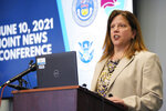 Deanne Reuter, special agent in charge of the Drug Enforcement Administration, makes a point during a news conference Thursday, June 10, 2021,in Centennial, Colo. Three agencies—the Drug Enforcement Administration, Homeland Security Investigations and the office of the district attorney in Colorado's 18th Judicial District—held the news conference to explain the major grand jury indictments issued in a money-laundering scheme involving the distribution of drugs by major cartels and how the money earned was then laundered through contacts in China. (AP Photo/David Zalubowski)
