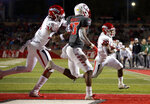 Fresno State running back Ronnie Rivers (20) sprints to the end zone to score a touchdown as teammate Cam Sutton (36) blocks New Mexico cornerback Jalin Burrell (13) during the first half of an NCAA college football game in Albuquerque, N.M., Saturday, Oct. 20, 2018. (AP Photo/Andres Leighton)