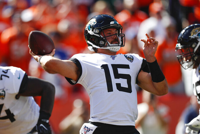 Jacksonville Jaguars quarterback Gardner Minshew throws a pass during the first half of an NFL football game against the Denver Broncos, Sunday, Sept. 29, 2019, in Denver. (AP Photo/David Zalubowski)
