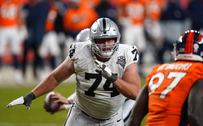 FILE - In this Sunday, Jan. 3, 2021 file photo, Las Vegas Raiders offensive tackle Kolton Miller (74) in the first second half of an NFL football game in Denver. The Las Vegas Raiders have agreed to a contract extension with left tackle Kolton Miller that will keep him locked up through the 2025 season. The deal reached Tuesday, March 30, 2021 was announced by Miller's agents at Octagon Football. The contract includes the 2022 fifth-year option and three additional seasons and is worth $68.7 million.(AP Photo/David Zalubowski, File)