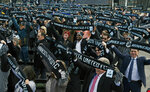 In this March 18, 2019, photo, soccer supporters wave scarves as Minnesota United FC Loons held a scarf raising ceremony in advance of the MLS soccer team's home opener April 13 against New York City FC in the new Allianz Field stadium in St. Paul, Minn. (AP Photo/Jim Mone)