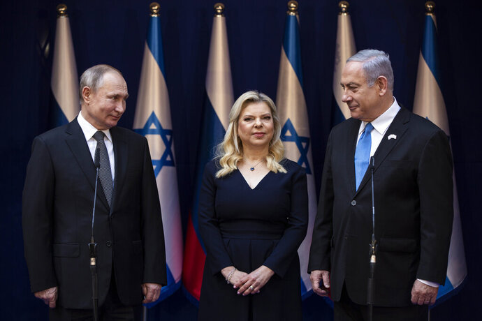 Israeli Prime Minister Benjamin Netanyahu and his wife Sarah stand with President Vladimir Putin at Netanyahu official residence in Jerusalem on January 23,2020 . Putin, will be a guest of honor Thursday at a ceremony at the Yad Vashem Holocaust Museum marking the 75th anniversary of the Soviet Red Army's liberation of the Nazi Auschwitz death camp. Presidents , prime ministers and royalty from around the world who arrived in Israel for the two-day World Holocaust Forum in Jerusalem, marking the 75th anniversary of the liberation of the Auschwitz-Birkenau concentration camp. (Heidi Levine/Pool photo via AP)