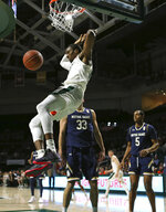 Miami center Ebuka Izundu (15) dunks against Notre Dame forward John Mooney (33) and D.J. Harvey (5) during the first half of an NCAA college basketball game, Wednesday, Feb. 6, 2019 in Coral Gables, Fla. (David Santiago/Miami Herald via AP)