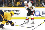 Ottawa Senators right wing Connor Brown, right, passes the puck past Nashville Predators defenseman Ryan Ellis, left, in the first period of an NHL hockey game Tuesday, Feb. 25, 2020, in Nashville, Tenn. (AP Photo/Mark Humphrey)