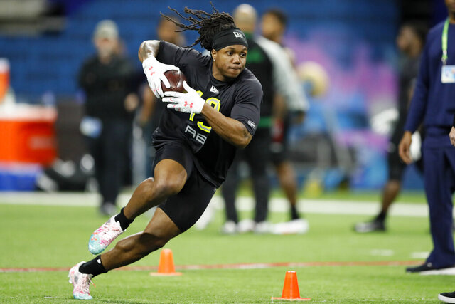 Maryland running back Anthony McFarland runs a drill at the NFL football scouting combine in Indianapolis, Friday, Feb. 28, 2020. (AP Photo/Charlie Neibergall)
