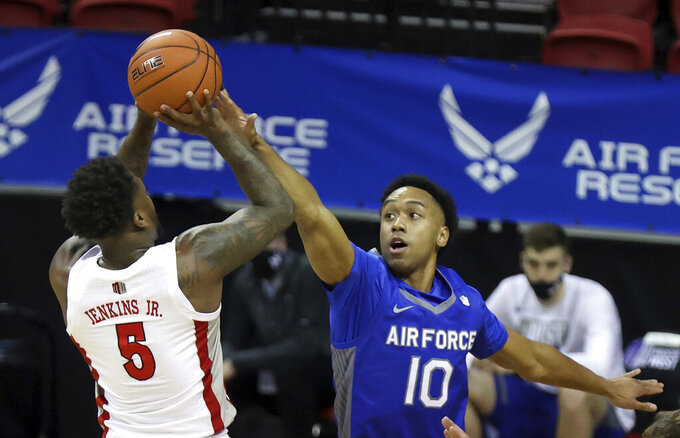 UNLV guard David Jenkins Jr. (5) shoots as Air Force guard A.J. Walker (10) defends during the first half of an NCAA college basketball game in the first round of the Mountain West Conference men's tournament Wednesday, March 10, 2021, in Las Vegas. (AP Photo/Isaac Brekken)