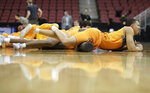 Tennessee's Grant Williams stretches during practice for the NCAA men's college basketball tournament, Wednesday, March 27, 2019, in Louisville, Ky. (AP Photo/Michael Conroy)