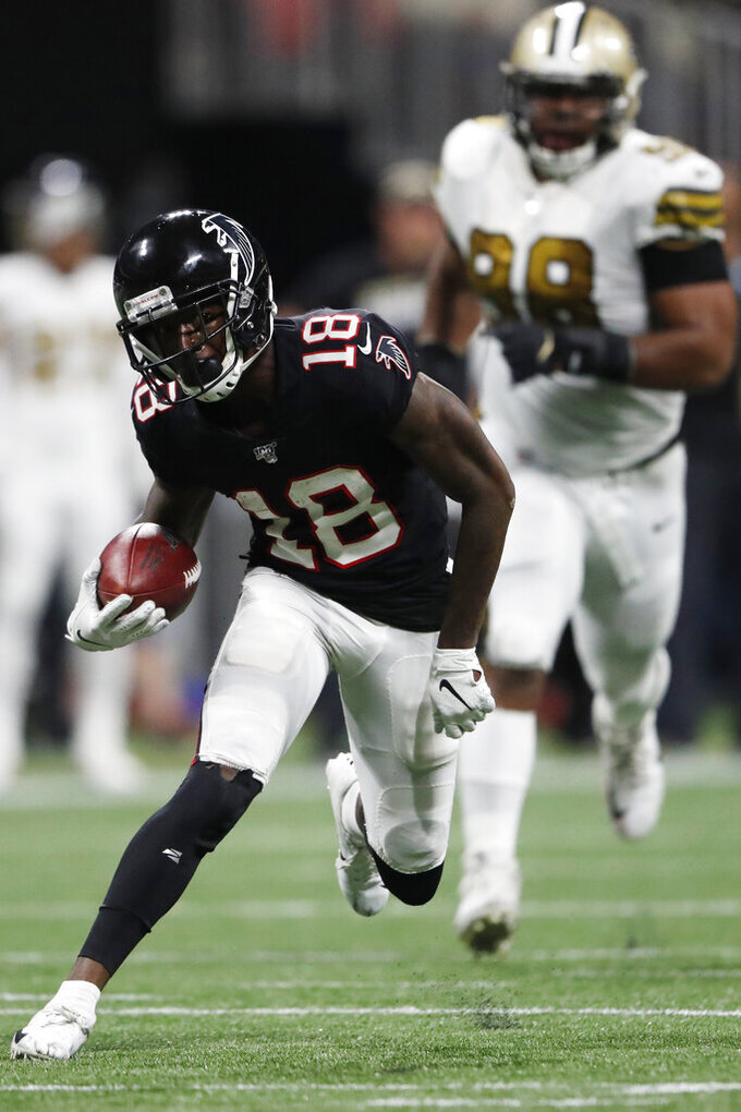 Atlanta Falcons wide receiver Calvin Ridley (18) runs against the New Orleans Saints during the second half of an NFL football game, Thursday, Nov. 28, 2019, in Atlanta. The New Orleans Saints won 26-18. (AP Photo/John Bazemore)