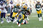Green Bay Packers' Aaron Jones runs for a touchdown during the second half of an NFL football game against the Chicago Bears Sunday, Dec. 15, 2019, in Green Bay, Wis. (AP Photo/Matt Ludtke)