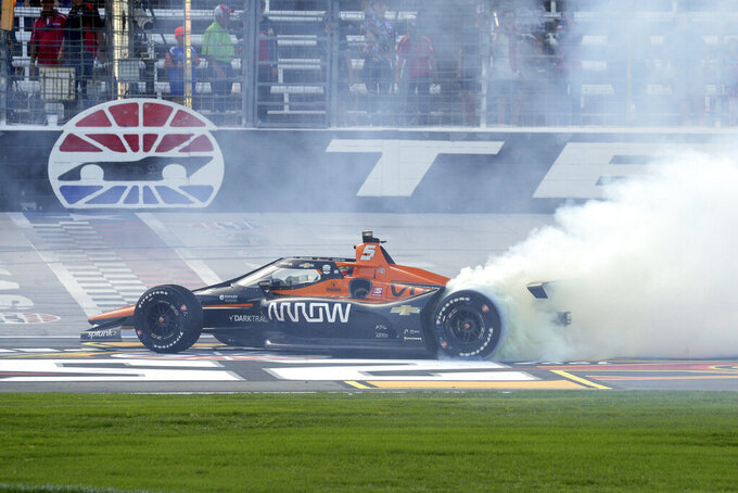 Pato O'Ward does a burnout on the track as he celebrates his victory at an IndyCar Series auto race at Texas Motor Speedway on Sunday, May 2, 2021, in Fort Worth, Texas. (AP Photo/Richard W. Rodriguez)
