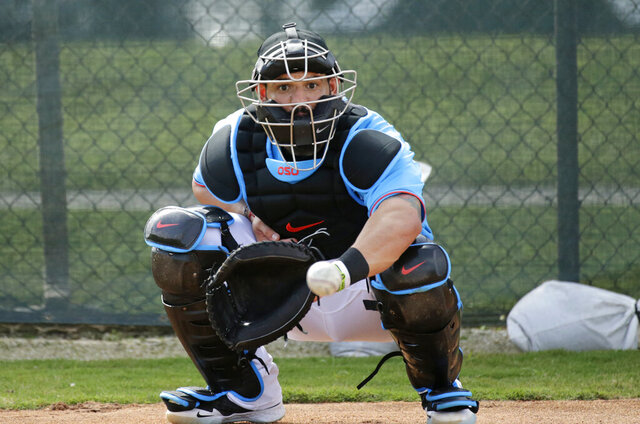 FILE - In this Feb. 12, 2020, file photo, Miami Marlins catcher Jorge Alfaro eyes the baseball during a spring training baseball workouts for pitchers and catchers at Roger Dean Stadium in Jupiter, Fla. Francisco Cervelli says he's fully recovered from his latest concussion, and Jorge Alfaro says he's feeling fitter after an offseason spent working on the farm and running sprints. At catcher, at least, the Miami Marlins appear in good shape. (David Santiago/Miami Herald via AP, File)