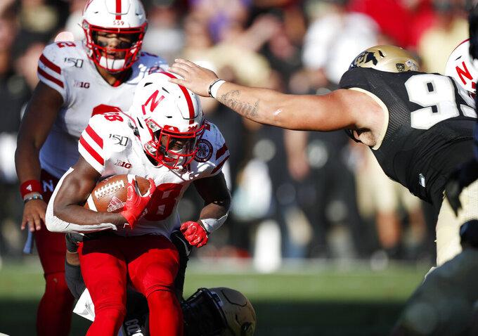 Colorado defensive tackle Jalen Sami, right, stops Nebraska running back Maurice Washington in overtime of an NCAA college football game Saturday, Sept. 7, 2019, in Boulder, Colo. Colorado won 34-31 in overtime. (AP Photo/David Zalubowski)