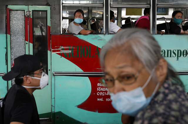 People ride a bus during the first day of a more relaxed lockdown that was placed to prevent the spread of the new coronavirus in Manila, Philippines on Monday, June 1, 2020. Traffic jams and crowds of commuters are back in the Philippine capital, which shifted to a more relaxed quarantine with limited public transport in a high-stakes gamble to slowly reopen the economy while fighting the coronavirus outbreak. (AP Photo/Aaron Favila)