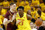 Maryland forward Bruno Fernando, right, of Angola, drives against Minnesota center Matz Stockman, of Norway, in the first half of an NCAA college basketball game, Friday, March 8, 2019, in College Park, Md. (AP Photo/Patrick Semansky)