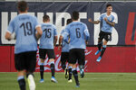 Uruguay's Brian Rodriguez, right, celebrates after scoring as teammates run to congratulate him during the second half of a friendly soccer match against the United States Tuesday, Sept. 10, 2019, in St. Louis. The game ended in a 1-1 tie. (AP Photo/Jeff Roberson)