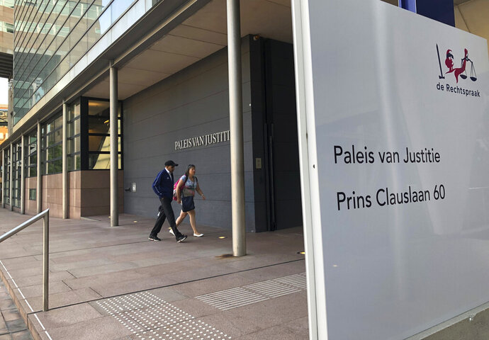 FILE - This Monday Aug. 26, 2019 file photo shows the outside of The Hague District Court. The Dutch court on Wednesday Sept. 11, 2019 acquitted a doctor in a landmark trial that prosecutors and physicians hope will help clarify how the country's 2002 euthanasia law can be applied to people with severe dementia. (AP Photo/Aleks Furtula)