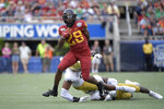 FILE - In this Dec. 28, 2019, file photo, Iowa State running back Breece Hall (28) rushes for yardage past Notre Dame defensive lineman Khalid Kareem (53) and linebacker Jeremiah Owusu-Koramoah (6) during the first half of the Camping World Bowl NCAA college football game, in Orlando, Fla. The Cyclones open Sept. 12, 2020, against Louisiana-Lafayette.(AP Photo/Phelan M. Ebenhack, File)