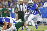 Kentucky running back Kavosiey Smoke (20) runs with the ball during the first half of an NCAA college football game between Kentucky and Eastern Michigan, Saturday, Sept. 7, 2019, in Lexington, Ky. (AP Photo/Bryan Woolston)