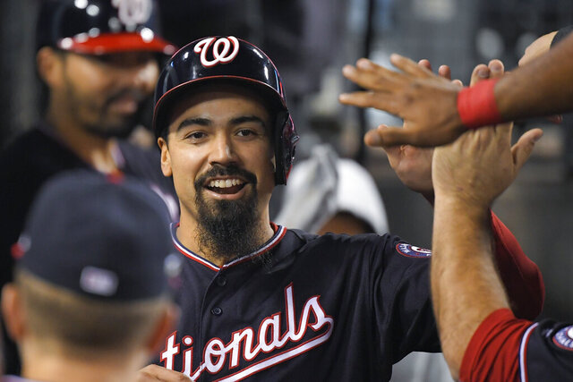 FILE - In this Oct. 9, 2019, file photo, Washington Nationals' Anthony Rendon celebrates in the dugout after scoring on a single by Juan Soto during the sixth inning in Game 5 of the baseball team's National League Division Series against the Los Angeles Dodgers in Los Angeles. The Los Angeles Angels paired Rendon, the best hitter on the free agent market, and Mike Trout, their three-time AL MVP, this winter at the heart of a lineup stocked with an array of tested veterans and promising youngsters. (AP Photo/Mark J. Terrill, File)