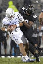 Tulsa quarterback Zach Smith (11) is sacked by Central Florida defensive lineman Joshua Celiscar (88) during the first half of an NCAA college football game Saturday, Oct. 3, 2020, in Orlando, Fla. (AP Photo/Phelan M. Ebenhack)