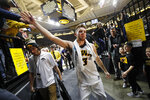 Iowa guard Jordan Bohannon celebrates with fans after an NCAA college basketball game against Northwestern, Sunday, Feb. 10, 2019, in Iowa City, Iowa. Bohannon made a three-point basket at the end of the game as Iowa won 80-79. (AP Photo/Charlie Neibergall)