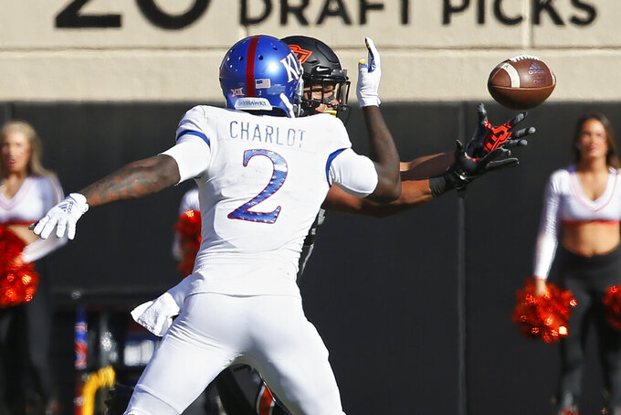 Oklahoma State safety Kolby Harvell-Peel, rear, intercepts a pass intended for Kansas wide receiver Daylon Charlot (2) in the second half of an NCAA college football game in Stillwater, Okla., Saturday, Nov. 16, 2019. (AP Photo/Sue Ogrocki)
