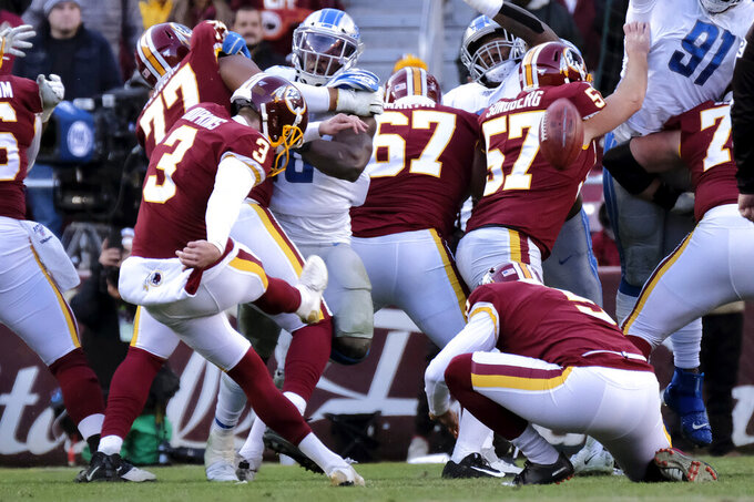 Washington Redskins kicker Dustin Hopkins (3), with Tress Way holding, kicks a field goal against the Detroit Lions during the second half of an NFL football game, Sunday, Nov. 24, 2019, in Landover, Md. (AP Photo/Mark Tenally)