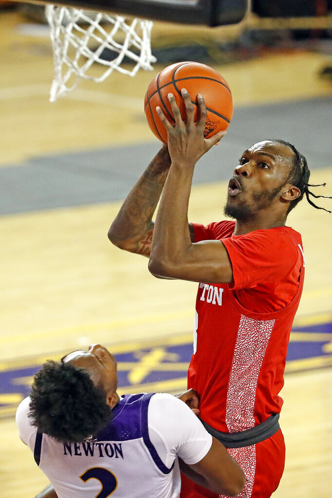 Houston's DeJon Jarreau (3) drives the ball into East Carolina's Tristen Newton (2) during the first half of an NCAA college basketball game in Greenville, N.C., Wednesday, Feb. 3, 2021. (AP Photo/Karl B DeBlaker)