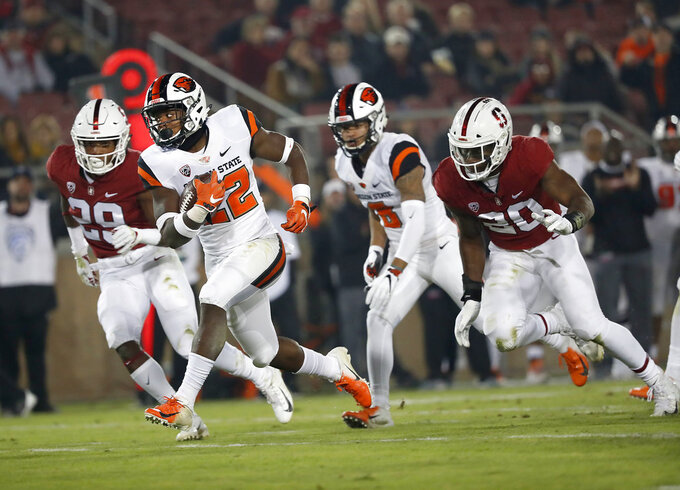 Oregon State running back Jermar Jefferson (22) rushes past Stanford linebacker Bobby Okereke (20) in the first half during an NCAA college football game on Saturday, Nov. 10, 2018, in Stanford, Calif. (AP Photo/Tony Avelar)