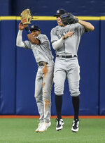 New York Yankees outfielders Greg Allen, left, and Aaron Judge celebrate the team's 4-3 win over the Tampa Bay Rays in a baseball game Tuesday, July 27, 2021, in St. Petersburg, Fla. (AP Photo/Steve Nesius)