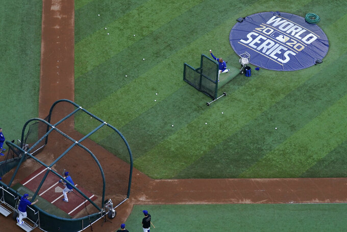 Members of the Tampa Bay Rays warms up during batting practice before Game 1 of the baseball World Series against the Los Angeles Dodgers Tuesday, Oct. 20, 2020, in Arlington, Texas. (AP Photo/David J. Phillip)