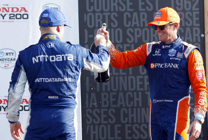 Scott Dixon, right, celebrates with teammate and second-place finisher Felix Rosenqvist after winning an IndyCar Series auto race, Sunday, July 28, 2019, at Mid-Ohio Sports Car Course in Lexington, Ohio. (AP Photo/Tom E. Puskar)
