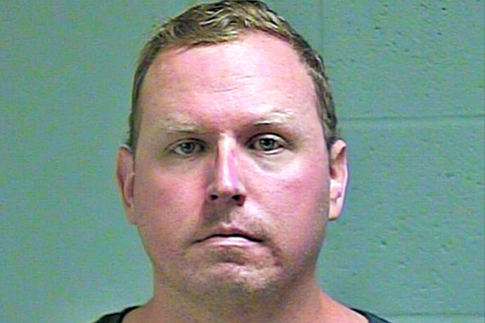 FILE - This undated file photo provided by the Oklahoma County Sheriff's Office shows Oklahoma City police Sgt. Keith Sweeney, who's charged with second-degree murder for killing Dustin Pigeon in November 2017. A jury is expected to begin deliberations Monday, Nov. 4, 2019, in the trial of an Sweeney who fatally shot Pigeon who had doused himself in lighter fluid and was threatening to set himself on fire. (Oklahoma County Sheriff's Office via AP, File)