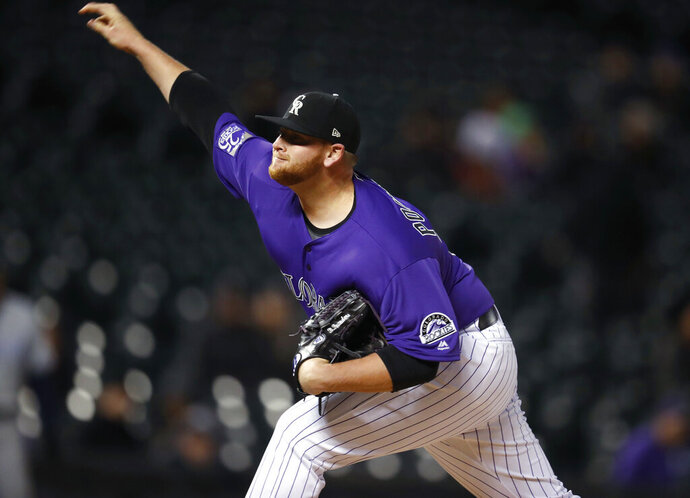 FILE - In this April 24, 2018, file photo, Colorado Rockies relief pitcher Brooks Pounders throws to a San Diego Padres batter during the ninth inning of a baseball game in Denver. The New York Mets have acquired Pounders from the Cleveland Indians for cash. Pounders, who had been pitching at Triple-A Columbus, was immediately added to the major league roster for Saturday night's game against St. Louis. The Mets also recalled right-hander Chris Flexen from Triple-A Syracuse and put him in the bullpen as well. (AP Photo/David Zalubowski, File)