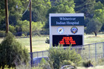 This Thursday, June 25, 2020 photo provided by C.M. Clay, shows sign at the entrance to the Whiteriver Indian Hospital in Whiteriver, Ariz., on the Fort Apache Reservation, The reservation, home to the White Mountain Apache Tribe, will be under lockdown this weekend to help slow the spread of the coronavirus. (C.M. Clay/White Mountain Apache Tribe via AP)
