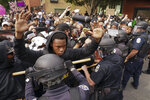 Police and protesters converge during a demonstration, Wednesday, Sept. 23, 2020, in Louisville, Ky. A grand jury has indicted one officer on criminal charges six months after Breonna Taylor was fatally shot by police in Kentucky. The jury presented its decision against fired officer Brett Hankison Wednesday to a judge in Louisville, where the shooting took place. (AP Photo/John Minchillo)