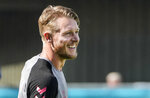 Denmark's captain Simon Kjaer smiles during a training session at the training ground in Helsingor, Denmark, Sunday, June 20, 2021 the day before the Euro 2020 soccer championship group B match between Denmark and Russia. (AP Photo/Martin Meissner)