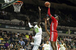Houston's Chris Harris Jr. shoots over South Florida's Madut Akec during the first half of an NCAA college basketball game Wednesday, Feb. 12, 2020, in Tampa, Fla. (AP Photo/Mike Carlson)